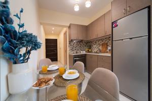 A kitchen or kitchenette at Bounatsa Studios & Apartments