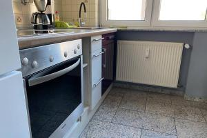 A kitchen or kitchenette at 2 Zimmer Apartment Duisburg Mitte