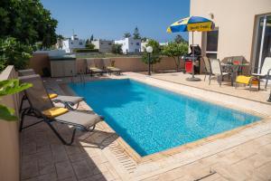 The swimming pool at or close to Cape Greco Villa Ekaterina