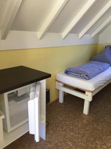 Ein Bett oder Betten in einem Zimmer der Unterkunft Campingplatz Aichelberg