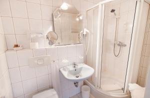 Ein Badezimmer in der Unterkunft Nordseehotel Freese