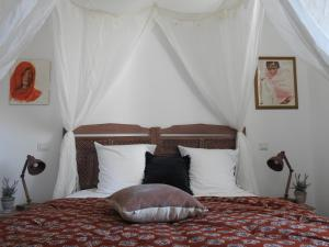 Un ou plusieurs lits dans un hébergement de l'établissement Villa Madura