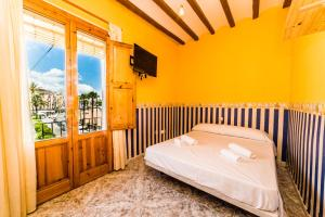 A bed or beds in a room at Seanema SunRise BeachFront