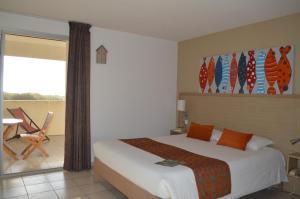Un ou plusieurs lits dans un hébergement de l'établissement Hotel L'Oceane
