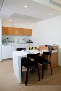 A kitchen or kitchenette at West All Suites Hotel Ashdod