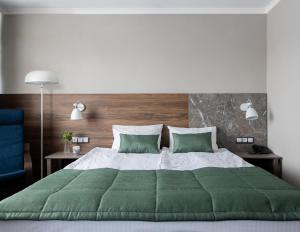 Кровать или кровати в номере Отель Челябинск - 4 этаж
