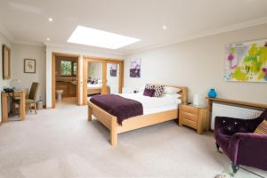 A bed or beds in a room at The Redgarth