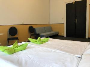 Ein Bett oder Betten in einem Zimmer der Unterkunft Welcome Hostel & Apartments Praguecentre