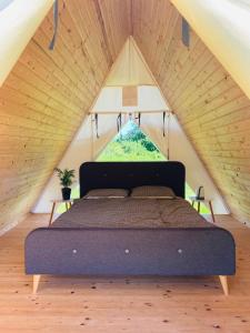 A bed or beds in a room at GreenValleyGlamping