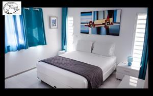Cama ou camas em um quarto em Moorea Sunset Beach