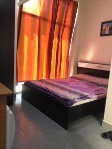 Cama ou camas em um quarto em Alp Hotel