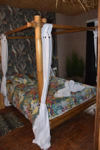 """Ein Bett oder Betten in einem Zimmer der Unterkunft """"Chez Ba'Nus"""""""