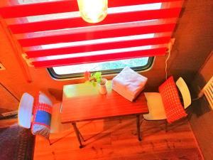 Un ou plusieurs lits dans un hébergement de l'établissement Chouette Tiny House