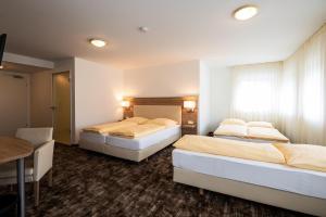 Ein Bett oder Betten in einem Zimmer der Unterkunft Sternplatz-Hotel