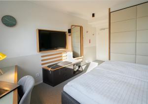 Ein Bett oder Betten in einem Zimmer der Unterkunft Hotel Am Leinritt