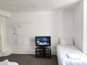 A television and/or entertainment center at Number 75