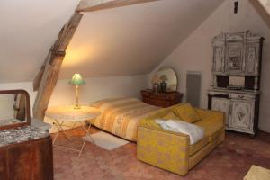 Un ou plusieurs lits dans un hébergement de l'établissement A la Ferme de la Joie - Chambres d'Hôtes