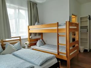 A bunk bed or bunk beds in a room at House L.A