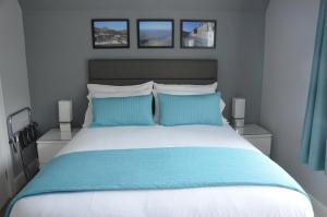 A bed or beds in a room at Portree Guest House