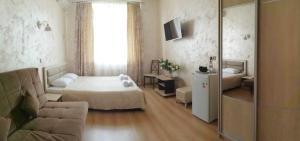 Кровать или кровати в номере Отель Андреевский