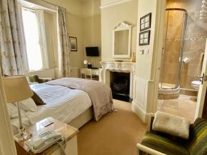 A bed or beds in a room at Newton House