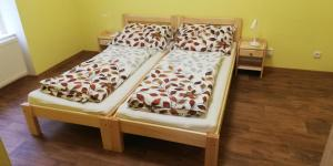 A bed or beds in a room at Booking Tržní