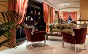 The lobby or reception area at c-hotels Fiume