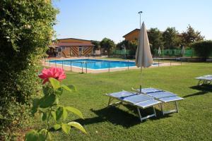 The swimming pool at or near Cascina Bosco Gerolo