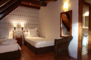 A bed or beds in a room at APARTAMENTOS VILAGAROs