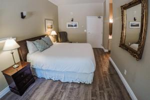 A bed or beds in a room at Lady MacDonald Country Inn