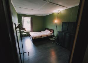 Кровать или кровати в номере Tarusa Apartment