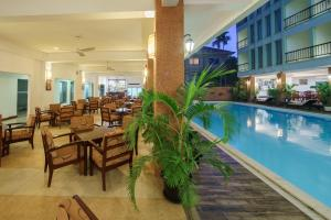 The swimming pool at or near Smiling Hotel