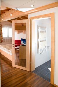 Ein Etagenbett oder Etagenbetten in einem Zimmer der Unterkunft Hotel Garni Ragaz