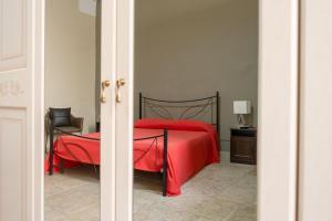 Letto o letti in una camera di B&B Santi Medici