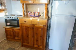 Η κουζίνα ή μικρή κουζίνα στο Βίλλα Μανδράκι