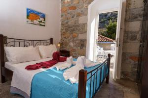 Ένα ή περισσότερα κρεβάτια σε δωμάτιο στο Βίλλα Μανδράκι