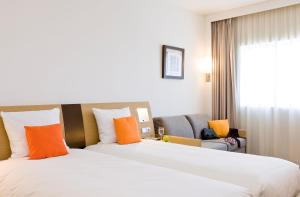 A bed or beds in a room at Novotel Constantine