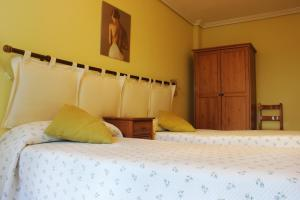 Cama o camas de una habitación en Apartamentos Rurales Altuzarra