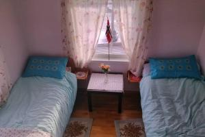A bed or beds in a room at Lofoten Apartment + Rooms - Skrova