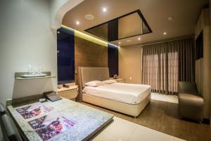 Cama ou camas em um quarto em Caribe Motel (Adult Only)