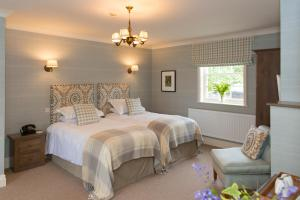 A bed or beds in a room at Tickton Grange Hotel