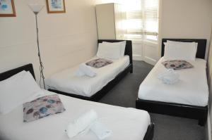 A bed or beds in a room at Istanbul Ev Guest House