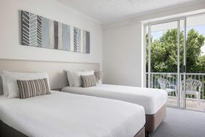 A bed or beds in a room at BreakFree Diamond Beach