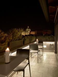 Uma varanda ou terraço em Trianon Borgo Pio Aparthotel