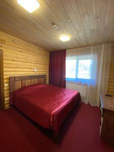 Ліжко або ліжка в номері Аквапарк Глухомань