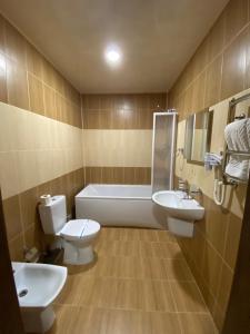 Ванна кімната в Аквапарк Глухомань