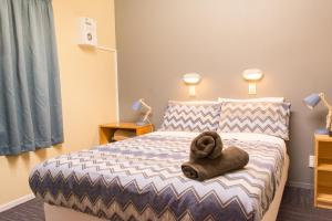 A bed or beds in a room at YHA Franz Josef