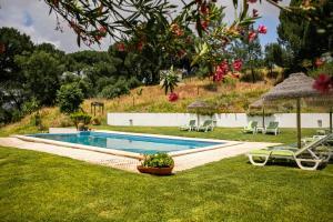 The swimming pool at or near Vdf - Vale De Ferreiros