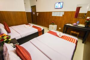 A bed or beds in a room at Botoum Hotel