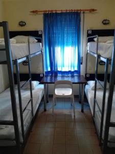 A bunk bed or bunk beds in a room at HI Lagos - Pousada de Juventude